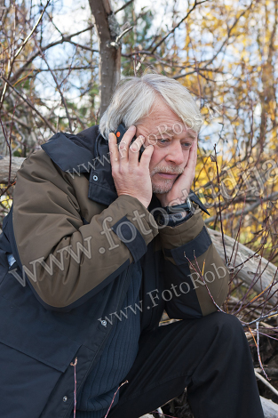 Mature middle-aged man in forest