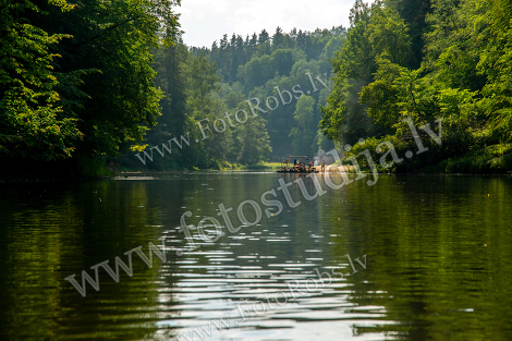 Trip by raft on the river during summer